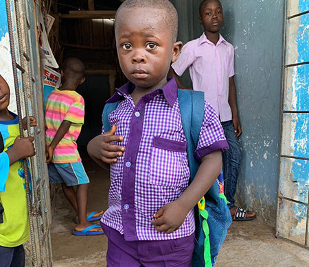 Hope for Liberia gives child a new uniform and backpack