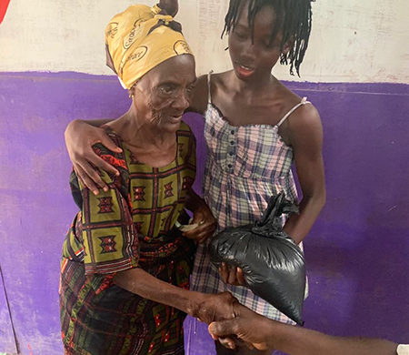 Hope for Liberia giving rice